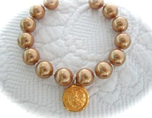 Pearl Strand Bracelet with Small Button Charm